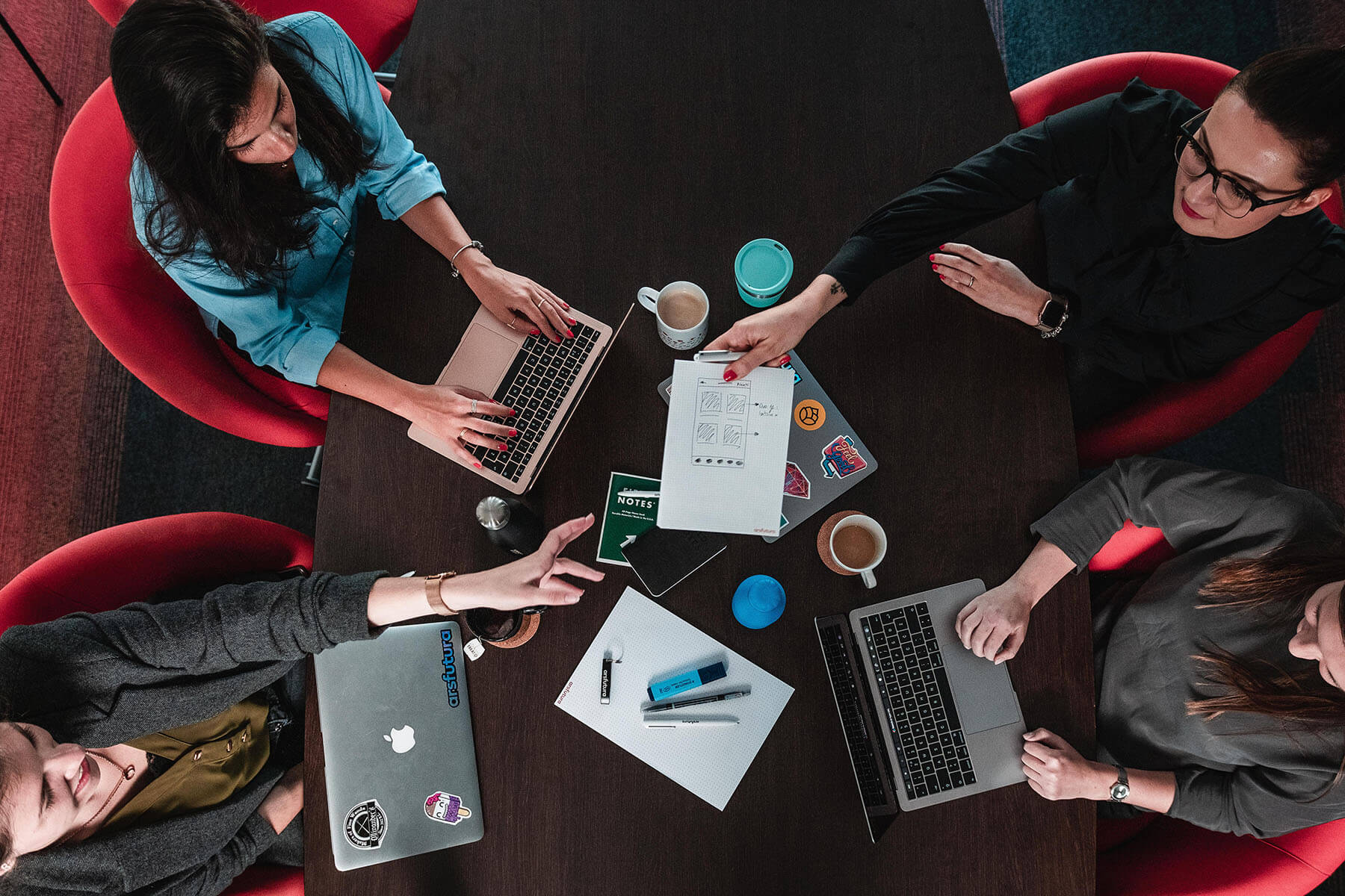 Image showing a few people sitting around a conference table.